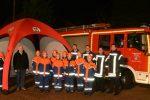 Auf dem Bild zusehen StJFW Mathias Rothenburg, Wilfried Sermond und die Jugendgruppe mit ihrem Betreuerteam